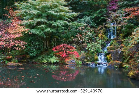 Tranquility: Autumn In The Japanese Garden In Portland. Turning Leaves And  Waterfall Reflected In
