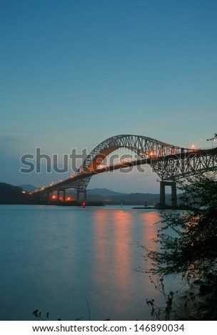 Trans American bridge in Panama connected South and North Americas in the sunset - stock photo