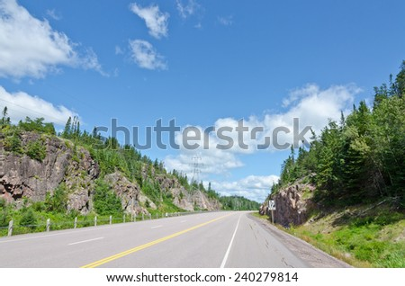 Trans Canada highway along Superior Lake shore - stock photo