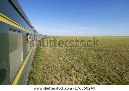 Trans Mongolian Train across the mongolian steppe, Mongolia - stock photo