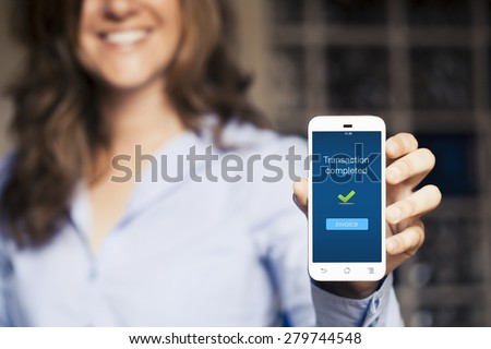 Transaction completed message. Woman showing her mobile phone. - stock photo