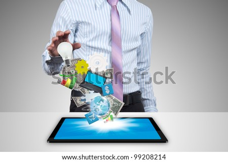 Transactions through the tablet of businessman.