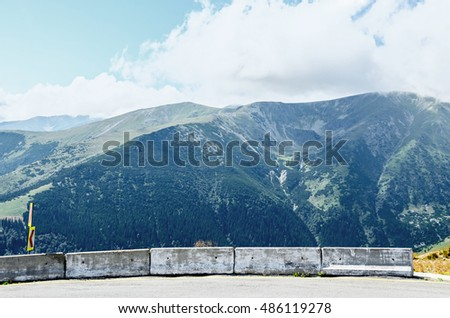 Transalpina road with rocks and grass hills,  Parang Mountains group, highest road of the Carpathian Mountains.