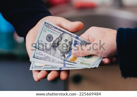 Transfer of money from hand to hand - stock photo