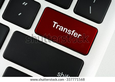 Transfer red keyboard button - financial, business, online and data concept - stock photo