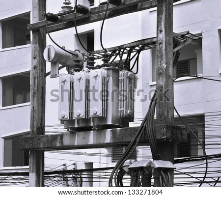 Transformer on a power pole in black and white