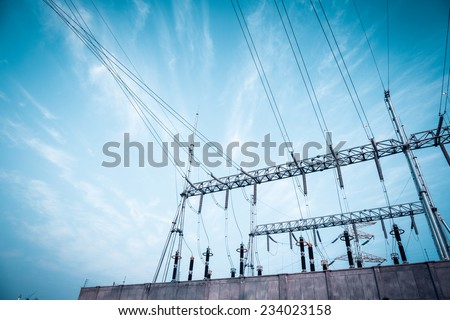 transformer substation against a blue sky ,electricity background  - stock photo