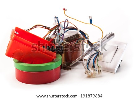 Transformers, switches, electrical tape, tester, electrical wires on a white background