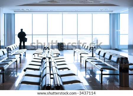 Transit lounge at the airport with human silhouette. - stock photo