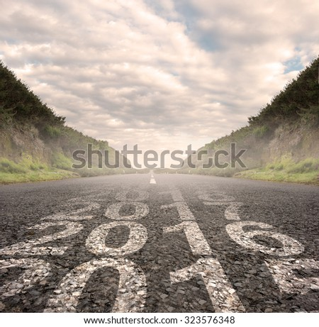 transition between year 2015 and year 2016 painted on asphalt road