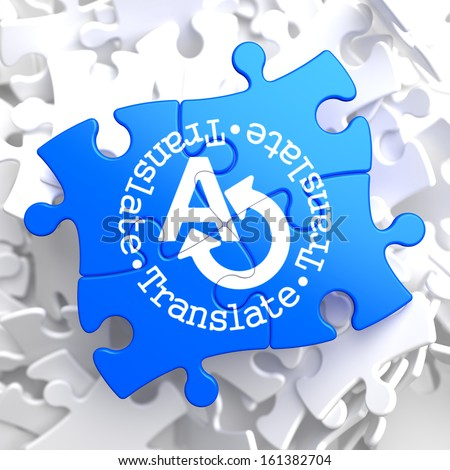 Translate on Blue Puzzle. Communication Concept. - stock photo