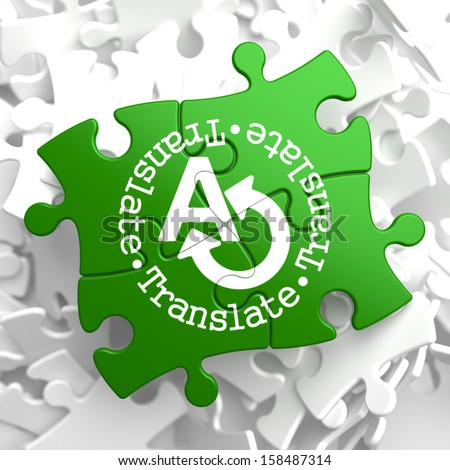 Translate on Green Puzzle Pieces. Communication Concept. - stock photo