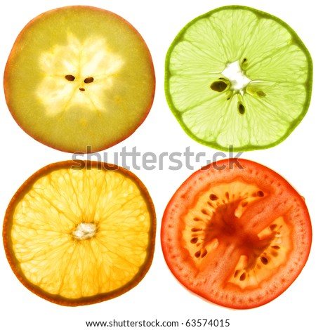 Translucent cut of a ripe apple, orange, tomato and green lemon. Isolated on white. - stock photo