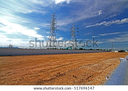 Transmission line tower on blue sky