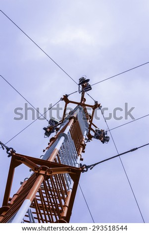 transmission tower against sky - stock photo