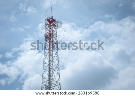 transmission tower against  sky and clouds - stock photo