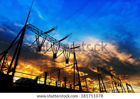transmission tower in the sunset - stock photo