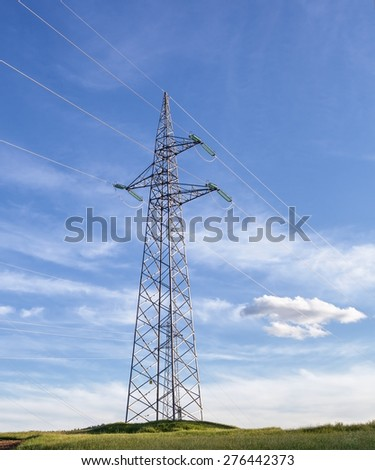 transmission tower or electricity pylon with blue sky with some clouds