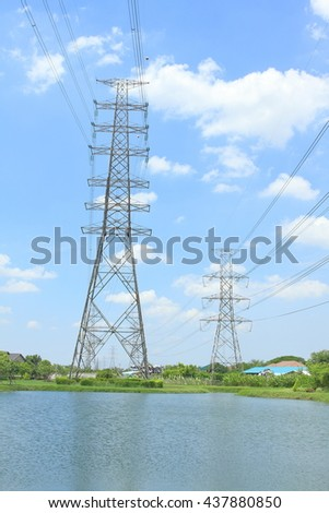 Transmission tower, power tower, electricity pylon, high voltage power lines, wire on blue sky background - stock photo