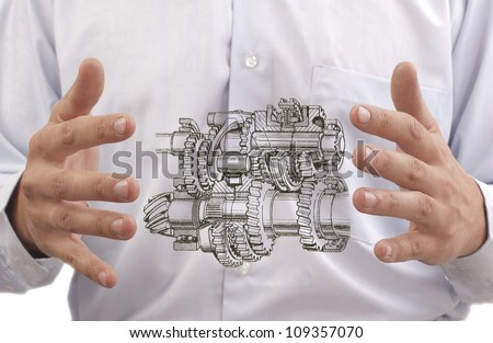 transmission with gears and shafts between the hands of the engineer on the background against the back of stomach Digestive system to the internal organs or process improvement programs trasmissii - stock photo