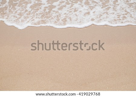 Transparent and clear sea water on the beach - stock photo