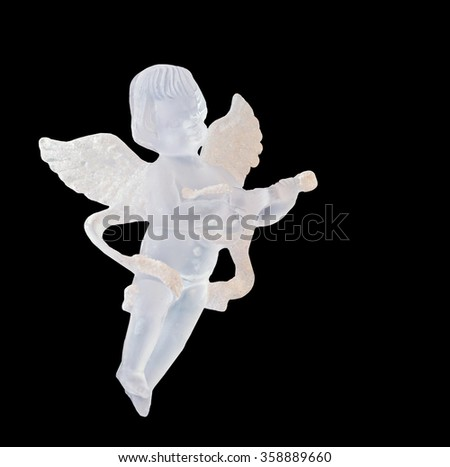 Transparent Angel ornament for Christmas tree, wings, singing, hanging, isolated, close up.