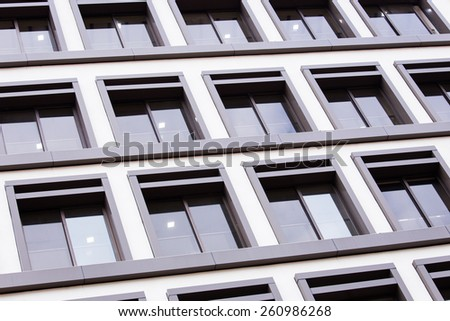 Transparent blue building windows of business center background - stock photo
