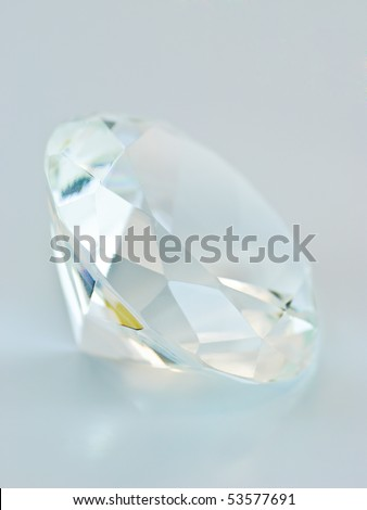 Transparent blue tinted round gemstone, lateral view - stock photo