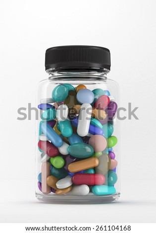 Transparent bottle with colorful pills isolated on white. - stock photo