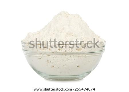 transparent bowl full of flour isolated on white - stock photo