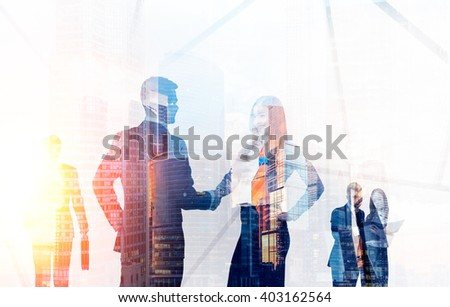 Transparent businesspeople silhouettes on Moscow city background. Double Exposure - stock photo