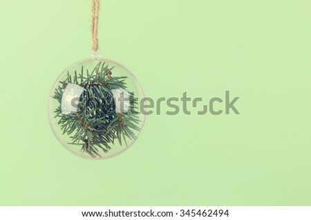 Transparent Christmas ball with a blue spruce inside. Christmas background - stock photo