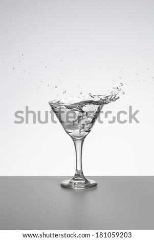 Transparent cocktail with splash