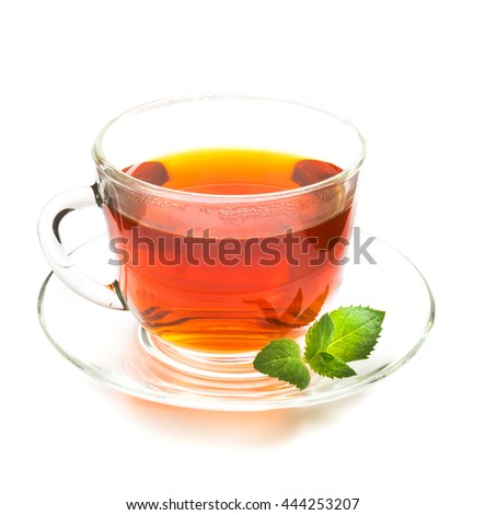 Transparent cup of black tea and mint leaves isolated on white background