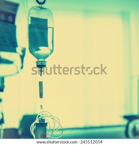 transparent drip bag and tubing, photo filter effect. - stock photo