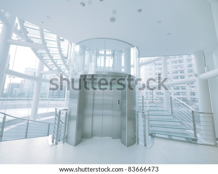 Transparent elevator and staircase - stock photo