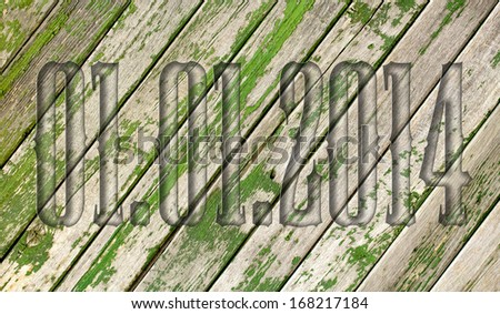transparent embossed on wooden background 01.01.2014 - stock photo