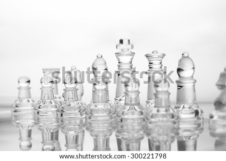 transparent glass chess on white background - stock photo