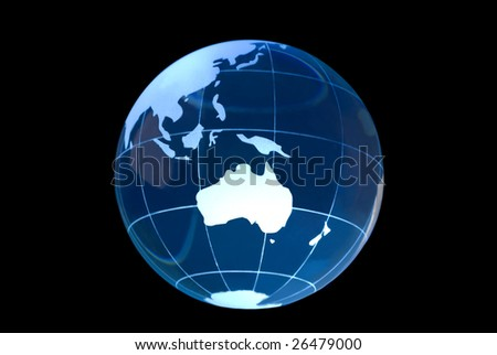 Transparent glass globe on black background with Australia featured. - stock photo