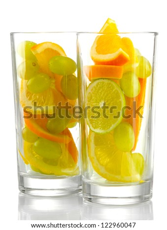 transparent glasses with citrus fruits, isolated on white
