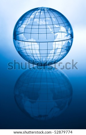 Transparent globe showing Europe and Africa with reflection. - stock photo