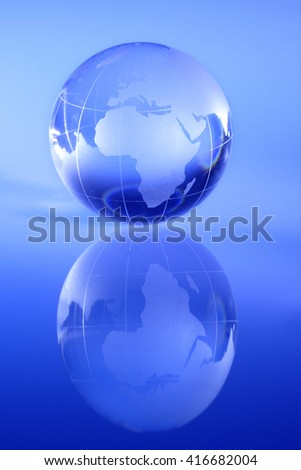 Transparent globe showing the world - stock photo