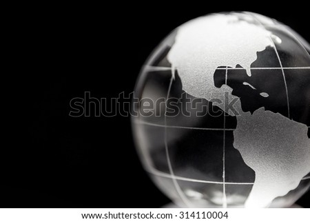 Transparent globe with black background - stock photo