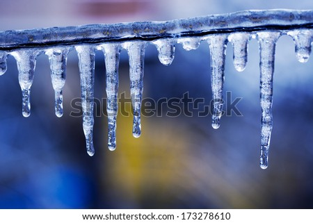 Transparent icicles on blurred background - stock photo