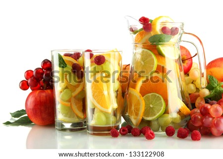 transparent jar and glasses with exotic  fruits, isolated on white
