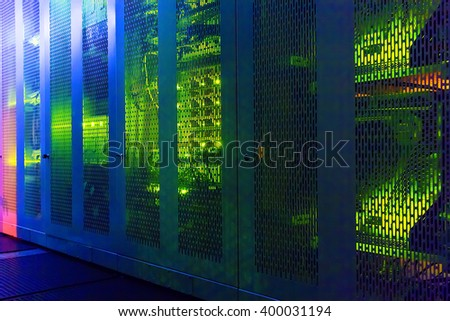 transparent modern communication equipment cabinets with lighting - stock photo