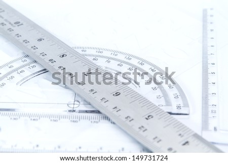 transparent plastic and aluminium rulers isolated on white