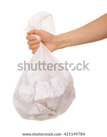 Transparent plastic bag with paper waste in a female hand isolated on white background. - stock photo