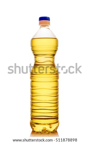 Transparent plastic bottle with oil closeup isolated on white background.