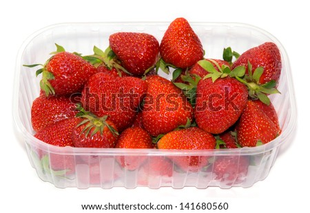 transparent plastic tray with freshly picked strawberries.  - stock photo
